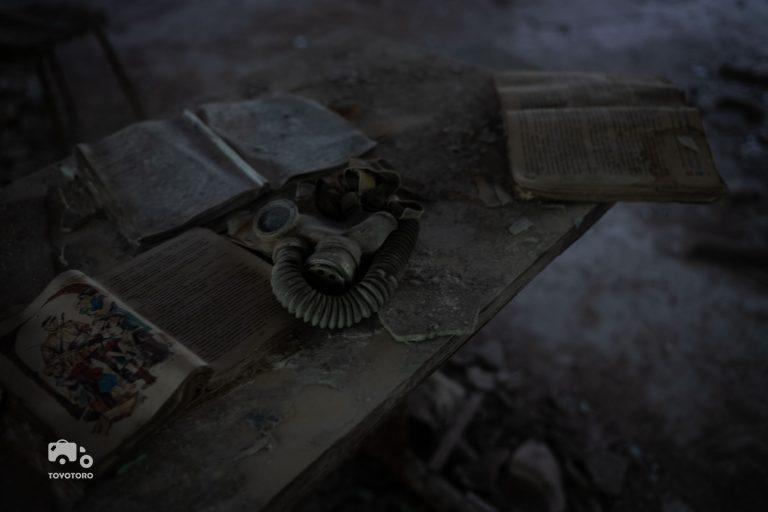 Gas masks on school desk in abandoned Pripyat elementary school
