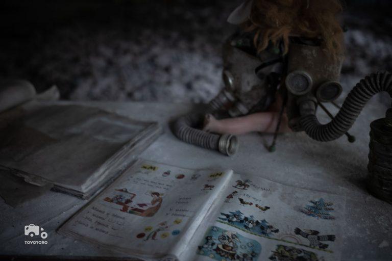 Gasmasks on school desk in abandoned Pripyat elementary school