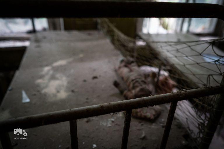 single bed in abandoned nursery